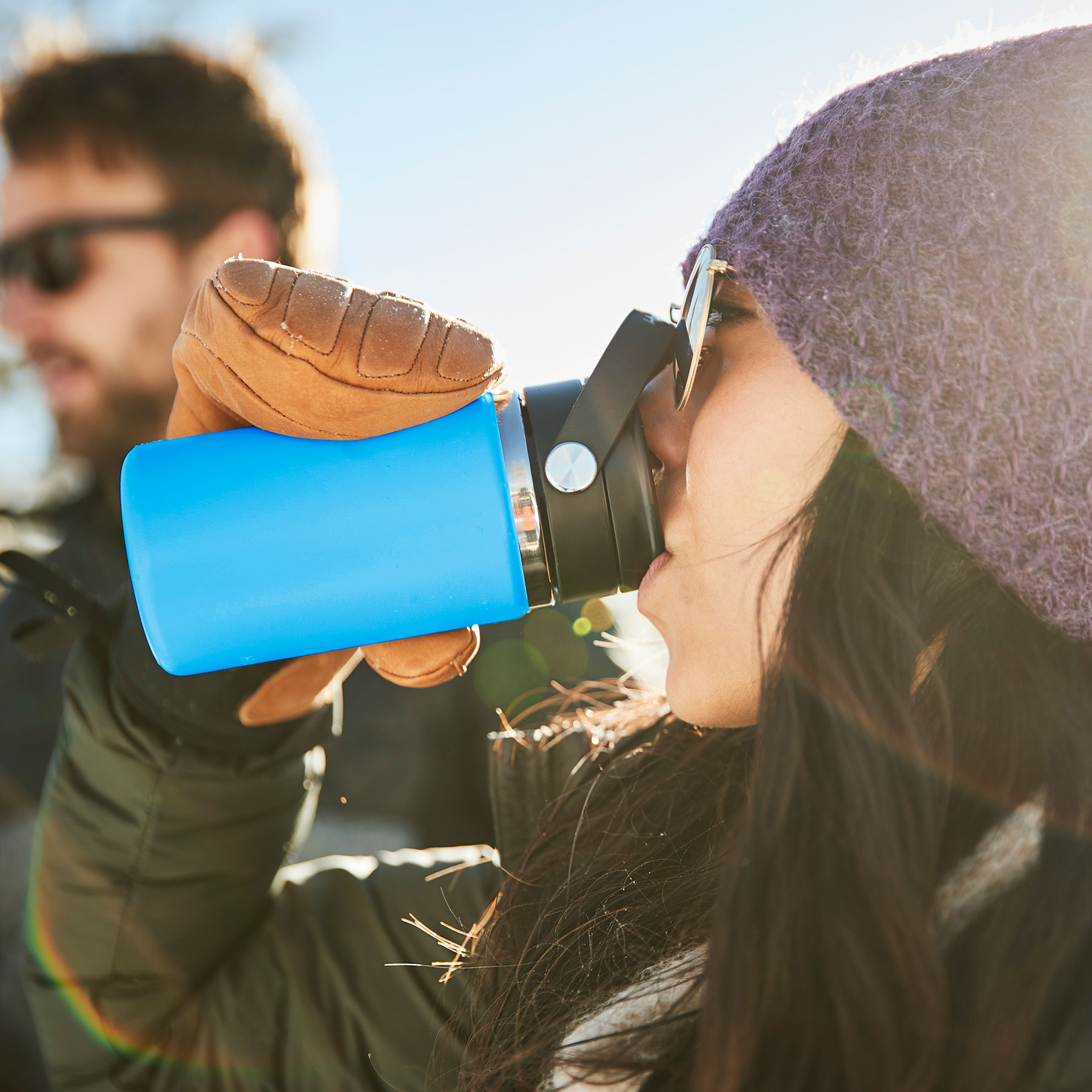 A girl is pictured taking a sip from her Flex Sip lid.